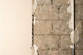Brick Wall With Construction Mark Under Plaster