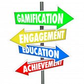 Gamification, Engagement, Education and Achievement words on arrow signs pointing you to the benefit