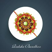 picture of rakhi  - Beautiful colorful rakhi on blue background for the celebrations of Hindu community festival Raksha Bandhan celebrations - JPG