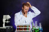 Crazy scientist working in laboratory