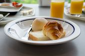 American Breakfast Closeup :croissant Bun And A Piece Of Bread