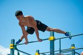 MOSCOW - JULY 26: Unidentified athlete performs during the street workout championship at Moscow City Games in Luzhniki on July 26, 2014 in Moscow.