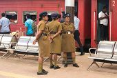 COLOMBO, SRI LANKA - MARCH 12, 2014: Three police women standing at train station. In 1952 women wer