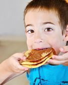 Boy Eating Pancakes