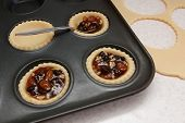 Filling Mince Pies With Mincemeat