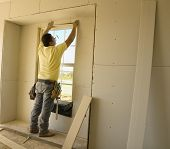 Working On The Window Sheetrock
