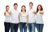 t-shirt design, gesture and people concept - group of smiling teenagers in blank white t-shirts showing thumbs up