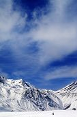 Winter Mountains And Blue Sky With Clouds