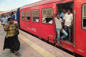 COLOMBO, SRI LANKA - FEBRUARY 22, 2014: Commuters in train at Colombo station. Trains are very cheap