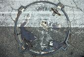 Manhole With Metal Cover With Zebra Crossing Marking Line On It