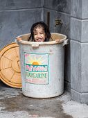 Homeless Girl Bathes In A Plastic Bucket, Philippines