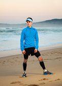 Athlete Standing On The Beach.