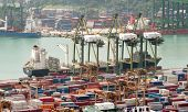 SINGAPORE - 2 JAN, 2014: Commercial port of Singapore. Busy harbor with hundred of vessels and trans