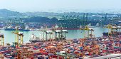 SINGAPORE - 2 JAN, 2014: Commercial port of Singapore. Bird eye panoramic view of busiest Asian carg
