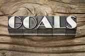 goals word in letterpress metal type printing blocks against weathered grained wood
