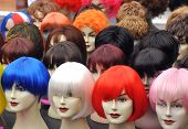 image of mystique  - Wigs on mannequins at a street market on Amsterdam - JPG