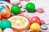Multicolored Sweets And Chewing Gum On A Wooden Table