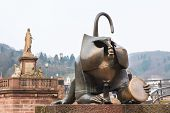 The Bronze Monkey Sculpture At The West Gate Of Old Bridge In Heidelberg, Germany