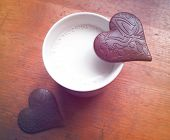 Two Heart-shaped pieces of chocolate
