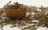 stock photo of salvia  - Medicinal herbal salvia tea leaves in bowl - JPG