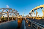 picture of bridge  - Metal arch bridge for cars and trains - JPG