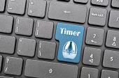 Blue timer key on keyboard