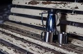 picture of thermos  - Thermos is on the bench in winter park - JPG