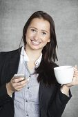 Happy Business Woman Drinking Coffee And Writing Sms