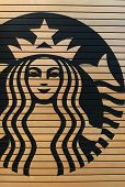 KUALA LUMPUR, - MAY 06: Starbucks Cafe logo on May 06, 2014 in Kuala Lumpur, Malaysia. Starbucks Corporation is an American global coffee company and coffeehouse chain based in Seattle, Washington