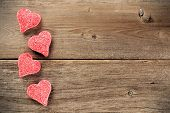 Valentines Day candies on wood background