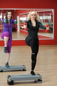 Step Aerobics In Gym With Dumbbells