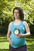 Blue Shirt Pregnant With Clock