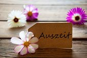 Label With German Text Auszeit With Cosmea Blossoms