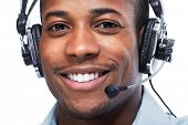 Man with headphones. Call center operator speaking with client