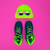 Stylish Fashion Sport Accessories: Sneakers, Sunglasses, Hat On Crimson Background