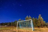 picture of starry  - Soccer pitch under starry sky at night - JPG