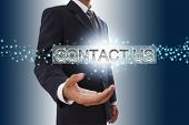 Businessman hand showing contact us.