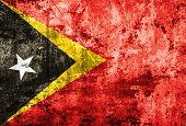 East Timor Flag on dirty paper.