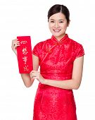 Woman with traditional cheongsam and holding Fai Chun, phrase meaning is dreams come true