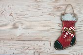 Christmas Background With A Stocking On Grunge Textured Wood Background