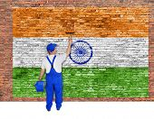 House Painter Covers Brick Wall With Flag Of India