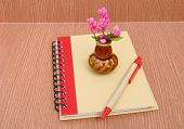 Small Vase On Notepad