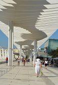 People walking in tourist street in Malaga, Spain