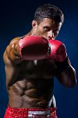 foto of boxers  - Strong muscular boxer in red boxing gloves - JPG