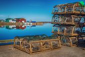 stock photo of lobster boat  - Old style lobster traps on a wharf if rural Prince Edward Island - JPG