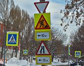 Road Signs At The Crossroads Of The Winter City.