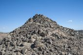 Rocky Desert Mountain With Blue Sky Background