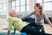 picture of physical therapist  - Physical therapist working with a senior woman at rehab - JPG