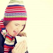 picture of sneezing  - Sneezing woman with handkerchief - JPG