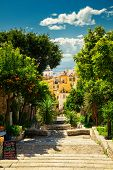 Street With Descending Steps In Taormina